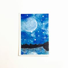 This original ACEO or Artist Trading Card (ATC) features a starry blue nebula sky. The moon floats above a reflective lake and a beautiful forest. The
