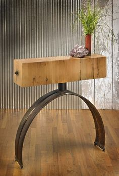 Console table made from barn beam and farm metal.