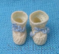 Baby booties newborn in off white color.
