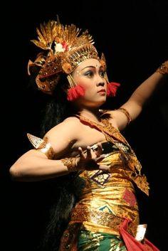 Balinese Legong dance, look at the dancer's beautiful eyes.