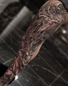 From Jesus to Mother Mary, Saints and beyond, discover the best Catholic tattoos for men. Explore cool and spiritual religious design ideas. Leg Sleeve Tattoo, Leg Tattoo Men, Tattoo Sleeve Designs, Tattoo Designs For Women, Arm Tattoo, Chest Tattoo, Religious Tattoo Sleeves, Religious Tattoos For Men, Tattoos For Guys