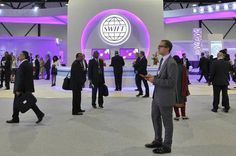 The Society for Worldwide Interbank Financial Telecommunication's booth at a 2013 conference in Dubai.