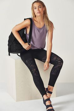 Move from downward dog to days on the go in our effortless high-low tank and seamless tights with a breathable lace jacquard design at the knees.