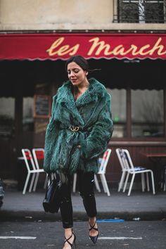 Isabel Marant rocks the 80's. Green fur coat+black Gucci belt+black vinyl pants+black pumps+black shoulder bag. Winter Dressy Casual Event Outfit 2017