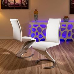Dining chairs set of 2 white faux leather modern Z shape C base. Dining Chairs Set of 2 White Faux Leather, Ultra Modern. Very high quality, extremely strong and durable. Call 02476 642139 or email sales@quatropi.com or visit www.quatropi.com for additional information.
