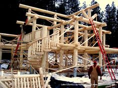 www.lakecountrylog.com Post and Beam Log Cabin Home with Handcrafted Spiral Log Stairs and Curved Railing Log Cabin Homes, Log Cabins, Cedar Log, Timber Frame Homes, Post And Beam, Western Red Cedar, Douglas Fir, Spiral, Stairs