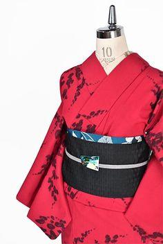 赤と黒のバイカラーで織りだされた、花枝のようなスポットパターンがモダンでアートな遊び心をくすぐるウールの単着物です。