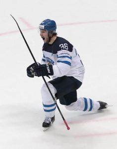 Jussi Jokinen celebrating his goal against Russia. Finland beat Russia on Saturday to set up an ice hockey world championship 2016 final against Canada. Ice Hockey Teams, Hockey Players, Hockey World, One Championship, Finland, Nhl, Beats, Russia, Canada