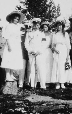 Grand Duchesses Maria, Olga and Tatiana with their father Emperor Nicholas, c.1911.