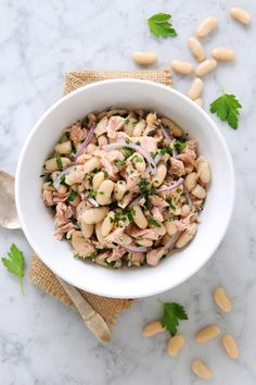 Blending the flavors of fragrant parsley, pungent red onion and nutty cannellini beans, this delicious cold salad introduces tuna to an otherwise classic dish.While it can be eaten alone, why not scoop it onto fresh arugula? For a seasonal touch, toss with halved cherry tomatoes.