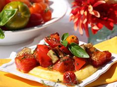 Roasted tomatoes, eggplant and peppers over polenta.  You may choose to add fennel, zucchini or green beans to the list of ingredients. Creamy, rosemary-scented polenta offers the perfect pillow to cradle all of the glittering colors.