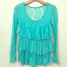 A super adorable lace top!  A really cute lace top with layers of frill. The lace is super elegant and pretty so it looks great for casual or formal wear! :) Tops