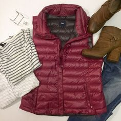 """Gap Down Puffer Vest in Raspberry Rolls up and stuffs into one of its own pockets for easy travel! Maroon/raspberry color.                               •21"""" underarm to underarm, 25"""" shoulder to hem                                                                            •Women's size large- 100% Nylon, 100% Down                                                 No trades nor lowball offers                                Thanks for shopping in my closet!! GAP Jackets & Coats Vests"""