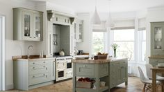 Inframe kitchen, cream oven in alcove. Wooden worktops, wooden section of island with marble worktop on island. Cosy Kitchen, Inframe Kitchen, Shaker Kitchen, Kitchen Units, Kitchen Doors, Kitchen Paint, Kitchen Ideas, Kitchen Handles, Kitchen Layout