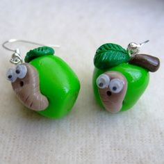 Green Apple and Maggot Earrings?  Ok, if I start wearing maggot earrings, I think I will have officially gotten off the fashion train.