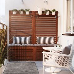 Ikea Outdoor Patio Furniture A Balcony With Brown Wooden Storage Benches With Seat Cushions, Wall Panels And Shelves Filled Ikea Outdoor, Small Outdoor Spaces, Outdoor Storage, Ikea Garden Storage, Outdoor Decking, Outdoor Benches, Ikea Storage, Outdoor Flooring, Modern Balcony