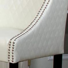 @Overstock - Ivory bonded leather with unique diamond-stitched pattern creates a stylish bar stool that will be the envy of guests. This stool also features a beautiful espresso finish on the wooden legs. http://www.overstock.com/Home-Garden/Milano-Ivory-Quilted-Bonded-Leather-Bar-Stool/4871480/product.html?CID=214117 $143.09