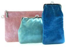 Puck, Suze and Minet. Leather clutches by Cellarich, Netherlands.