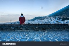 Tourist Observing A Panoramic View Of Blue City Of Chefchaouen At Rising…