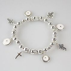 Accessory Accomplice Silvertone Mustard Seed & Cross Charm Silvertone Bead Stretch Bracelet Accessory Accomplice http://www.amazon.com/dp/B00IV4M8H0/ref=cm_sw_r_pi_dp_oCo-tb0NY13E5