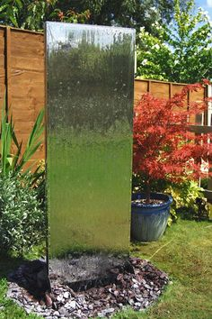 CLICK HERE for more details Water Wall - Vertical wall (120cm x 45cm) Water cascades gently down both sides of this graceful water wall with giving an all-round effect. Made from polished stainless steel, it is supplied complete with 4000 litre / hour pump and can be