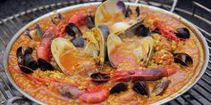 Andrew Zimmern Cooks: Grilled Seafood Paella – Andrew Zimmern Grilled Paella Recipe, Grilled Seafood, Fish And Seafood, Grilled Red Snapper, Best Superbowl Food, Andrew Zimmern, Poached Salmon, Food & Wine Magazine, Roasted Root Vegetables
