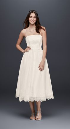 This short and flirty dress is perfect for any of your wedding events, but especially perfect for your casual wedding! Shop this Dotted Tulle Tea Length Strapless Wedding Dress by Galina at David's Bridal