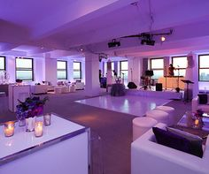 Purple lighting livens a clean white lounge, setting the tone for a fabulous evening of dancing and dining.