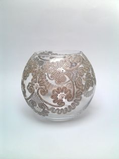 Hand painted vase  Lace came a very delicate, graceful, airy. Openwork glass vase is looked very tenderly and decorate any interior. Round vase Lace elegantly emphasize the beauty of the bouquet or will serve as an independent piece of interior. The vase will be exclusive gift for colleagues, friends, and loved ones for absolutely all occasions: birthday, wedding, anniversary, housewarming. Painting vase made in the style of point to point. For painting were used outlines on glass pearl…
