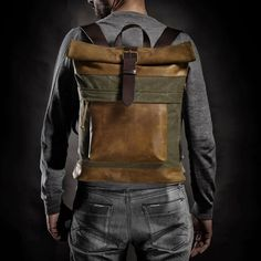 Canvas and leather backpack with military vintage elements