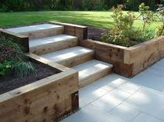 Sleeper retaining walls and pavior capped steps landscaping Garden stairs, Sloped garden Back Gardens, Outdoor Gardens, Small Gardens, Sleeper Retaining Wall, Backyard Retaining Walls, Retaining Wall With Steps, Wooden Retaining Wall, Retaining Wall Gardens, Small Retaining Wall