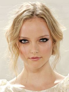 Rachel Zoe keeps her model's smoky eye romantic and soft with pink cheeks and a undone bun.