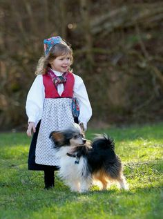 In a red wool bodice and a black trimmed skirt she is dressed for any festive occasion that might appear. Animals For Kids, Animals And Pets, Baby Animals, Baby Friends, Best Friends For Life, Little Girl Photography, Kids Zone, Folk Fashion, Beautiful Children