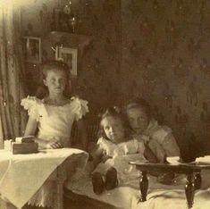 "Grand Duchesses Olga and Tatiana Nikolaevna Romanova of Russia with their brother, Tsarevich Alexei Nikolaevich Romanov of Russia in 1906. ""AL"""