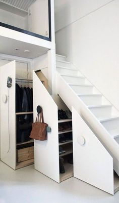 Stair storage cloakroom
