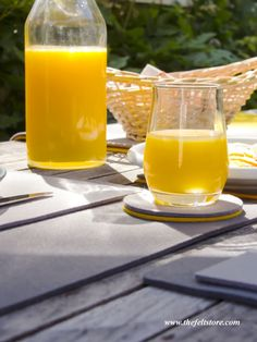 Sit back, relax, and enjoy the rest of your summer with a tall glass of juice and a felt coaster underneath it to protect your table