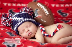 Newborn pics !! I bought the hat from Chloe's crochet corner she makes them any color combo you want. The background was a Texans blanket a friend of ours gave us for a wedding present the photographer just draped it out on his set.