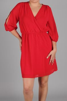 Can be found in our preorder section on Facebook. Beautiful red dress with peek-a-boo sleeves.