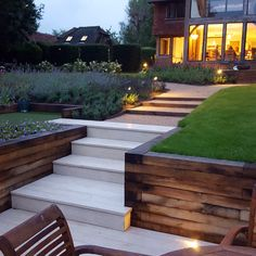 Millboard deck steps lead up through the oak sleepers on to the Breedon gravel path flanked on one side by the lawn and on the other by the golf tee. Garden designed by Anthony Paul Landscape Design, constructed by Bushy Business Gardens. Sloped Backyard, Sloped Garden, Modern Backyard, Modern Landscaping, Backyard Landscaping, Sunken Patio, Sunken Garden, Terrace Garden, Railway Sleepers Garden