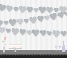 A delicate paper garland with heart shapes in silver. Hang this decoration from the ceiling or window at a wedding or another special occasion. Complete the party with more decorations from our silver wedding decoration range. Garland measures 2.74m (9') long.