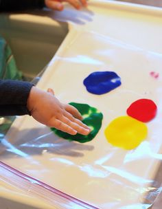 "finger painting in a LARGE baggie  GREAT for the younger child, ""tasters"" and on the go mess free fun"