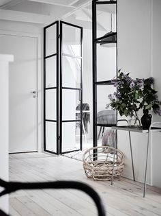 25 Home Decoration Organization and Storage Tips Attic bedroom with black metal frame door divider. Photo by Anders Bergstedt The Best of home interior in Interior Design Blogs, Home Interior, Interior Inspiration, Interior Doors, Hallway Inspiration, Industrial Door, Industrial Interiors, Steel Doors And Windows, Wood Doors