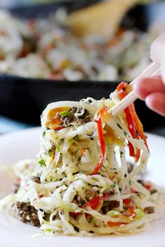 Asian Skillet Slaw recipe- This dish really packs in all the colors and textures in a delicious grain free one-pot meal.