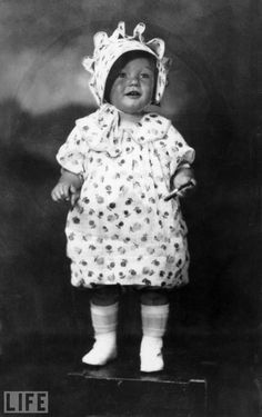 Marilyn Monroe Learns to Pose at Age 2  Long before Monroe becomes one of the most frequently photographed women in history, a 2-year-old Norma Jeane Baker poses in a California portrait studio in 1928.