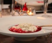 norsk ris- krem, traditional christmas dessert in Norway. A Sweet cooked rice (w/sugar) made into a pudding, then a special semi-thick raspberry syrup - you pour over your Ris Creme... It's utterly divine.