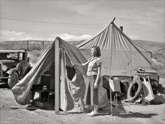 """July 1936. """"Many fruit tramps live in tents like these. Yakima, Washington."""" Slang for the itinerant agricultural workers, many of them Dust Bowl refugees, who picked apples, pears and cherries in the Pacific Northwest. Photo by Arthur Rothstein for the Resettlement Administration."""
