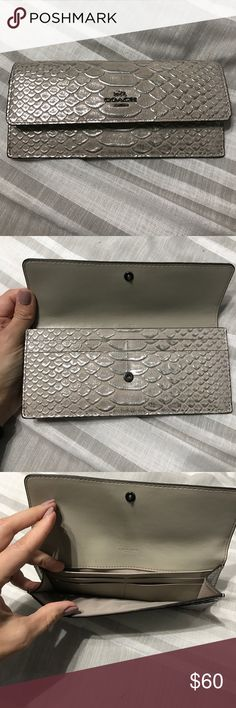 Coach wallet Beige color with silver metallic snakeskin. Hardware is gunmetal. Gently used. Non-smoking. Coach Bags Wallets