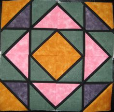 Stained Glass Quilt Block 5, called Canadian Gardens. From Foundation Pieced Stained Glass Quilts by Liz Schwartz and Stephen Seifert.