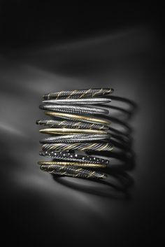 Stack David Yurman bracelets of different textures  and mixed metals for a striking effect.  #DavidYurman #Bracelet #Jewelry #ThanksgivingGift  176 Broadway, New York, NY 10038   212-732-0890