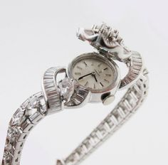 Omega Lady's Platinum and Diamond Bracelet Watch with Concealed DIal | From a unique collection of vintage wrist watches at https://www.1stdibs.com/jewelry/watches/wrist-watches/